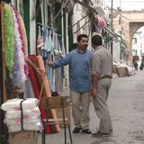 Men speaking in Tripoli. Tripoli, Lybia - May 02, 2002: Men speaking in Tripoli suq Royalty Free Stock Photo