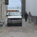 Men walking in the street. Tripoli, Lybia - May 28, 2002: Men walking in the streets of Tripoli Royalty Free Stock Photo