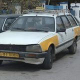 Old taxi car. Tripoli, Lybia - May 02, 2002: Taxi in the street of Tripoli Royalty Free Stock Photography