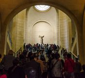 Trippers admire Winged Victory of Samothrace, also called the Ni. PARIS - APRIL 07: Tourists walk in Museum Louvre on April 07, 2013 in Paris, France. Winged Stock Photos