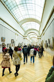 Trippers in the visit of Louvre Museum Stock Photo