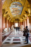 Trippers in the visit of Louvre Museum Stock Photography