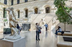 Trippers in the visit of Louvre Museum Royalty Free Stock Photos