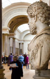 Trippers in the visit of Louvre Museum Stock Photos