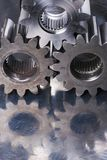 Tripple cog, gears idea. Three cogs, gears, reflecting in bluish stainless-steel stock image
