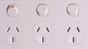 Tripple low voltage power wall outlets Stock Images