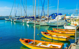 The trips in Tel Aviv. The sailing yachts wait in port for the romantic trips, Jaffa port, Tel Aviv, Israel royalty free stock photo