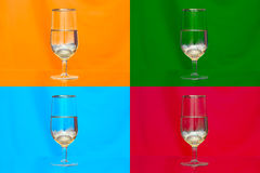 Triptych glass of champagne on orange, green, blue and red backg Stock Photography