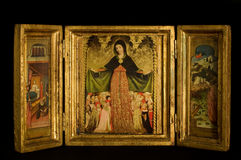 Triptych with Virgin and Child flanked archanges Stock Photography