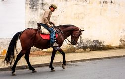 Triqueros, Huelva, Spain. A typical Spanish scene. A gypsy ? leaves the cafe and goes home on his horse Stock Images