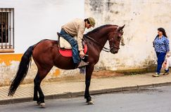 Triqueros, Huelva, Spain. A typical Spanish scene. A gypsy ? leaves the cafe and goes home on his horse Stock Photos