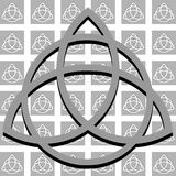 Triquetra on spotted background in black and white. The esoteric symbol of the triquetra on a texture in grigrio tones Royalty Free Stock Images