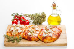 Tris of mixed pizza on wood Royalty Free Stock Images