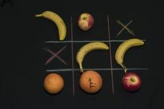 Tris-Spiel mit Frucht Stockfotos