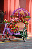 Trishaw. Colour Trishaw decorated with flowers stock images