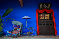 Trishaw and Cheong Fatt Tze Stock Image