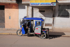 A trishaw with driver and passenger. Royalty Free Stock Image