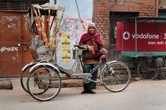 Trishaw driver on the street cold foggy morning in winter at Varanasi Stock Photo