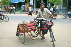 Trishaw driver waiting for customer in Mandalay Royalty Free Stock Image