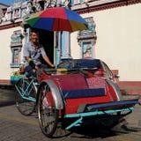 Trishaw-Fahrt, Penang, Malaysia Stockbilder