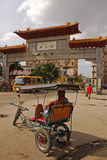 Trishaw in front of the main gate entrance of Havana Chinatown in Cuba Stock Image