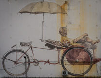 Trishaw Man Street Art in George Town Penang. Street Art depicting a Trishaw Man in George Town, Penang Stock Photos