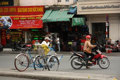 Trishaw and motorbikes in Saigon city, Vietnam Royalty Free Stock Images