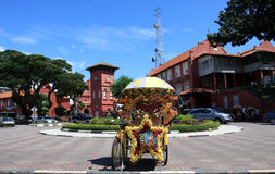 The trishaw ride in Malacca. MALACCA, MALAYSIA - DECEMBER 6:The design of the famous hi-tech decorative trishaw on December 3, 2011 in Malacca . The trishaw ride Stock Images