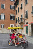 Trishaw with woman inside Stock Images