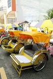 Trishaws. Image of traditional trishaws parked at the roadside stock photo