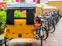 Trishaws expect passengers on the street Royalty Free Stock Photos
