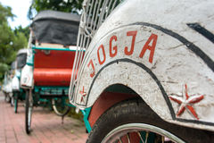 Trishaws in the street of Yogyakarta Royalty Free Stock Image