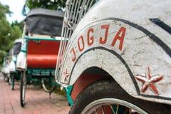 Trishaws in the street of Yogyakarta Royalty Free Stock Image
