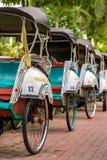 Trishaws on the street of Yogyakarta, Indonesia Stock Images