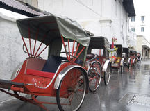Trishaws waiting in the rain. In Georgetown, Penang, Malaysia Royalty Free Stock Photo