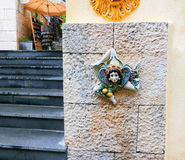 Triskelion - das Motiv, das in der Flagge von Taormina verwendet wurde, fand auf einem die Wände, Sizilien-Insel, Italien Stockfoto
