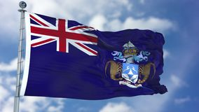Tristan da Cunha Flag in einem blauen Himmel stockbilder