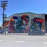 Tristan Eaton mural in LA Arts District. Full view of a mural by street artist Tristan Eaton on the facade of a building in the Arts District of Los Angeles Stock Photo