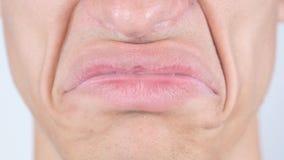 Triste, cercano para arriba de los labios de la cara del hombre Imagen de archivo libre de regalías