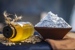 Triticum,wheat flourwith seeds and a bottle of common cooking oil. Royalty Free Stock Photography