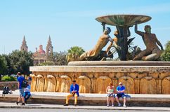 Triton fountain at City Gate into Valletta old town. Valletta, Malta - April 3, 2014:  People at Triton fountain at the City Gate into Valletta old town, Malta Royalty Free Stock Photo