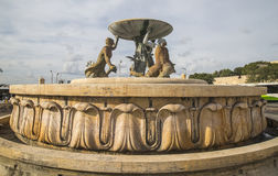 The Triton Fountain at the entrance to Valletta on Malta. Royalty Free Stock Image