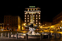 Triton Fountain in Rome at night Stock Photos