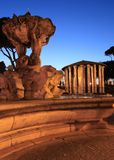 Triton fountain and temple of Ercole Vincitore Royalty Free Stock Photography