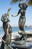 Triton And Nereid Puerto Vallarta Mexico. Sculpture of Triton And Nereid stands under a clear blue sky on El Malecon in Puerto Vallarta Mexico Royalty Free Stock Photography