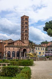 Tritons fountain and Basilica of Saint Mary in Cosmedin - Rome, Italy Stock Images