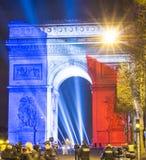 Triumfalny łuk zaświecał up z kolorami Francuski obywatel fl Zdjęcie Stock