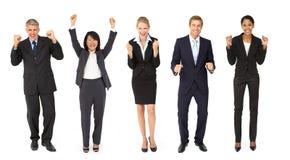 Triumfera grupp av affärsmän och kvinnor arkivfoton