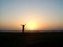 Triumph. Silhouette of a man exhulting Royalty Free Stock Photography