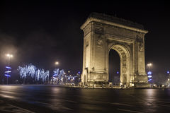 Triumph Arch. Arc de triomphe in a boulevard bucharest romania at night with lights Stock Images